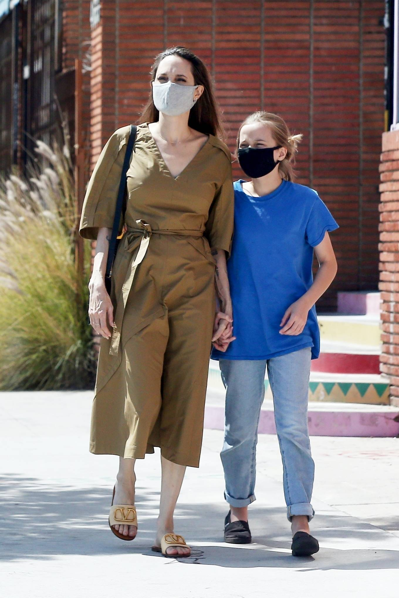 Angelina Jolie wearing brand logo Nude Dior open toe sandals with flat heel
