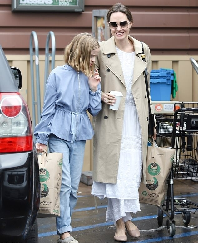 Angelina Jolie rocking round Nude leather mules with flat heel