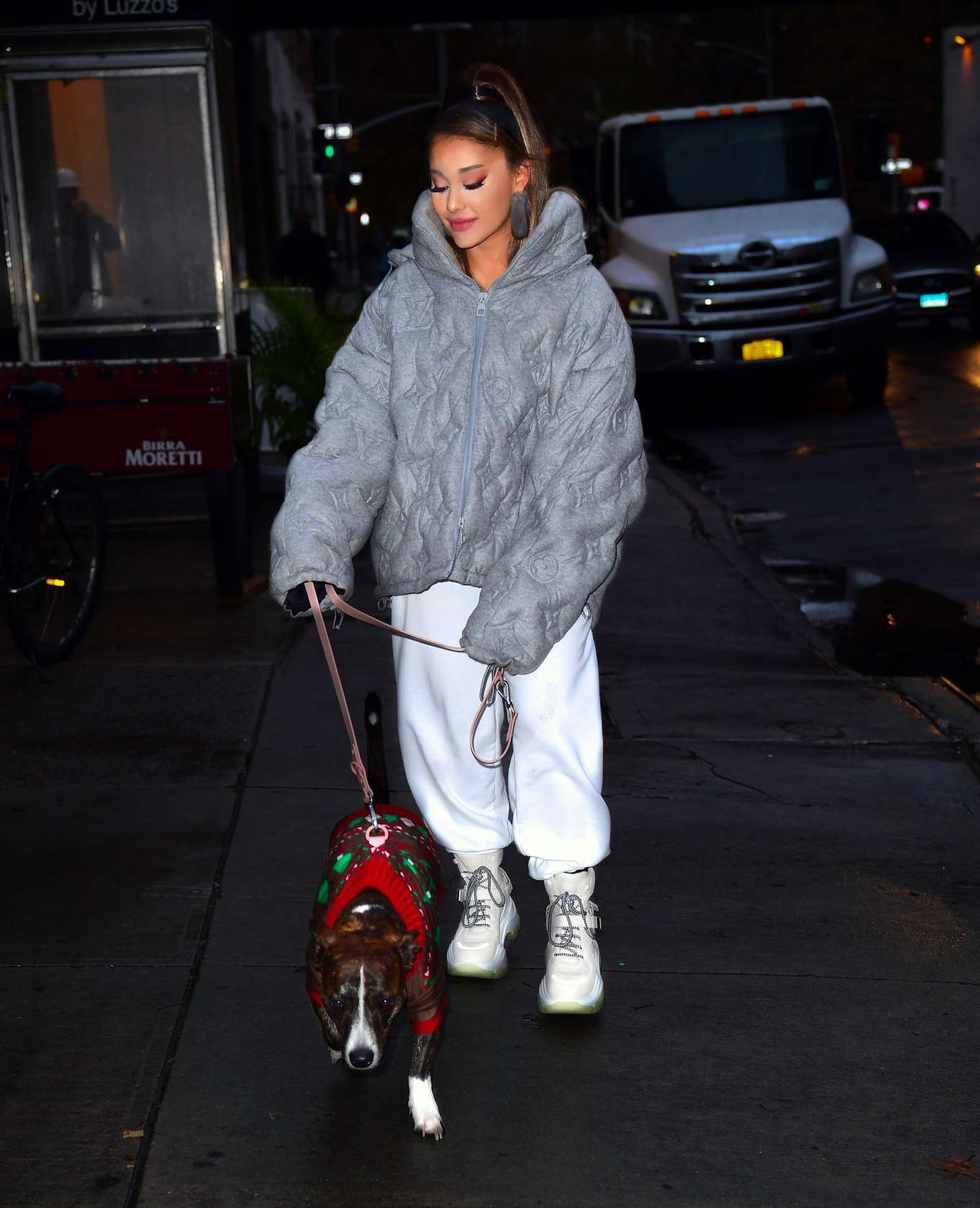 Ariana Grande donning white baggy sweatpants with ribbed hem