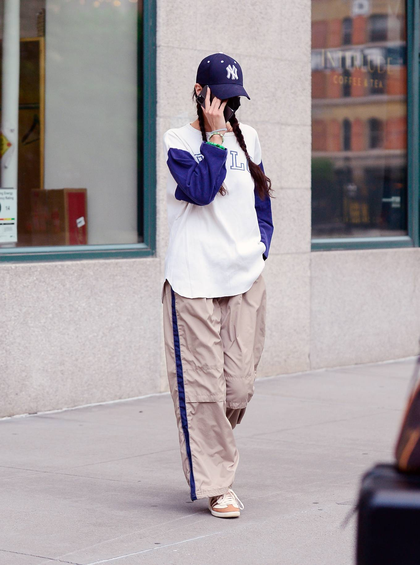 Bella Hadid, white sneakers, Adidas sneakers, oversized white graphic tee, round, lace-up, nude trousers. Bella Hadid wearing round white Adidas lace-up sneakers