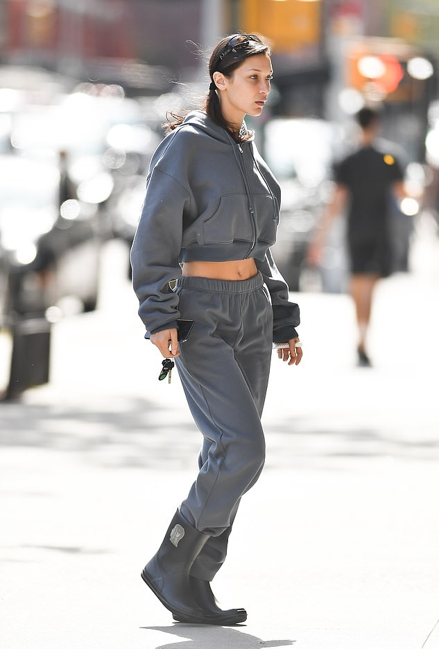 Bella Hadid rocking a oversized Danielle Guizio crop top with a cotton material, full sleeves and drawstring