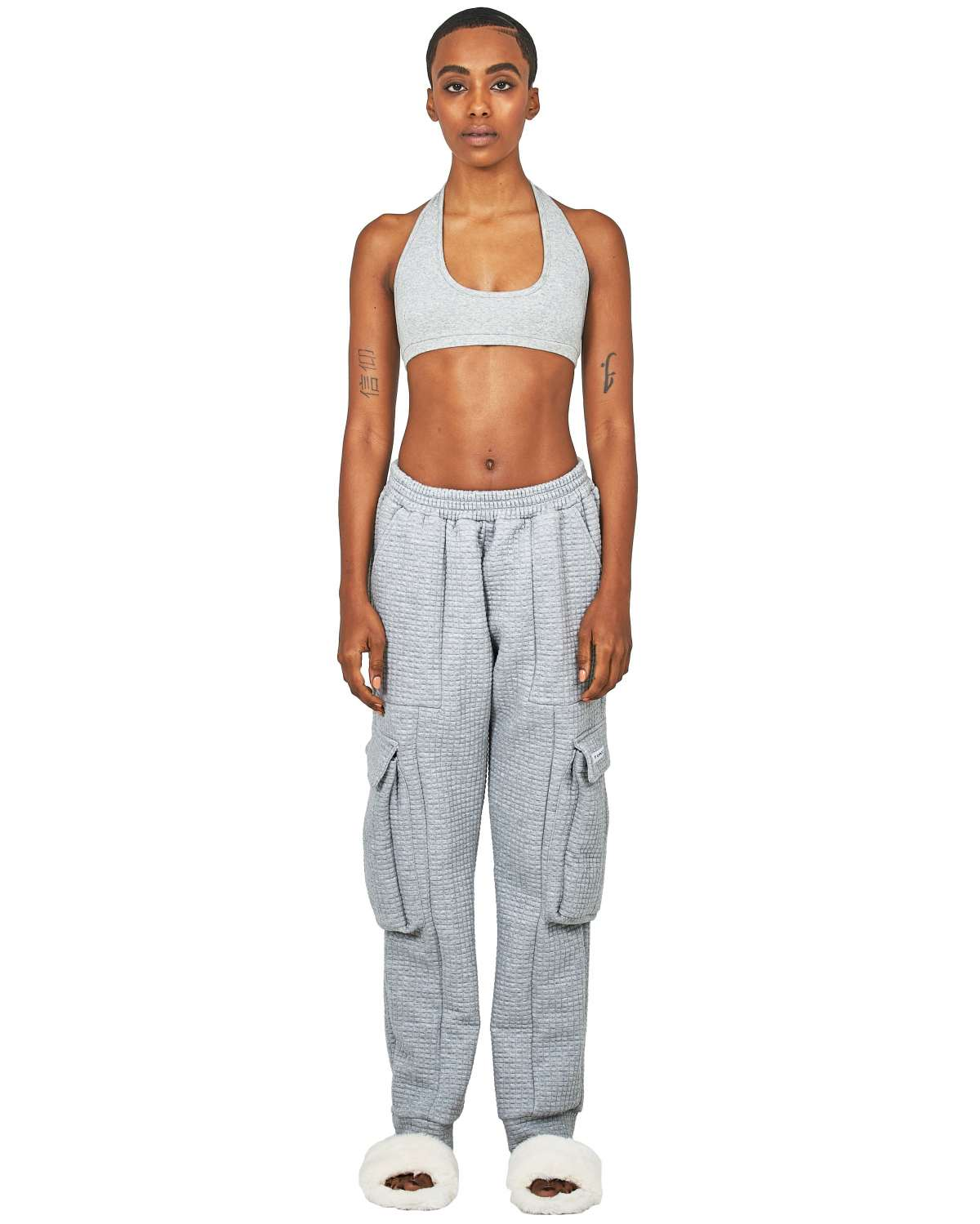 Bella Hadid rocking loose fit light blue cashmere ribbed hem joggers with waffle texture and button embellishment