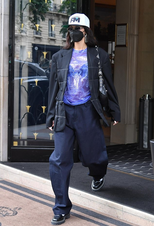 Bella Hadid wearing round black leather loafers by Far Fetch