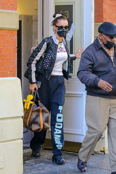Bella Hadid wearing black sweatpants with hued with a polyester fabric