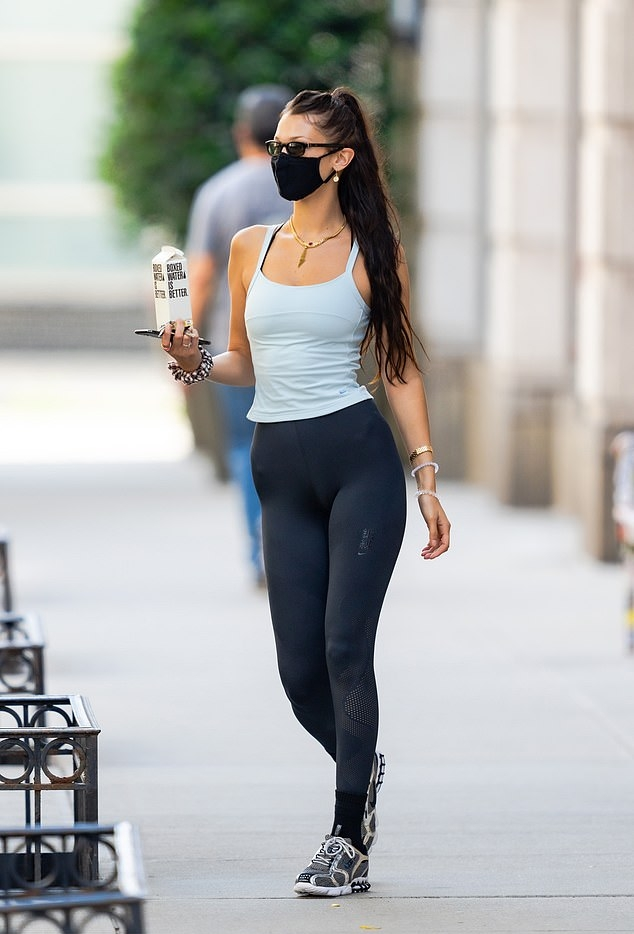 Bella Hadid rocking round black Nike lace-up sneakers with chunky sole and cage detailing