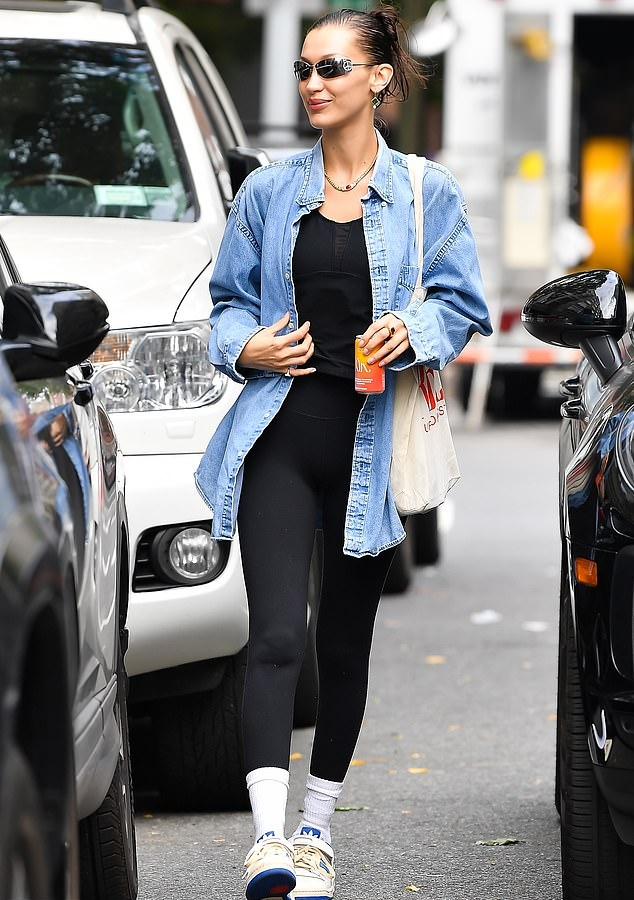 Bella Hadid rocking brand logo white blue lace-up sneakers by Adidas