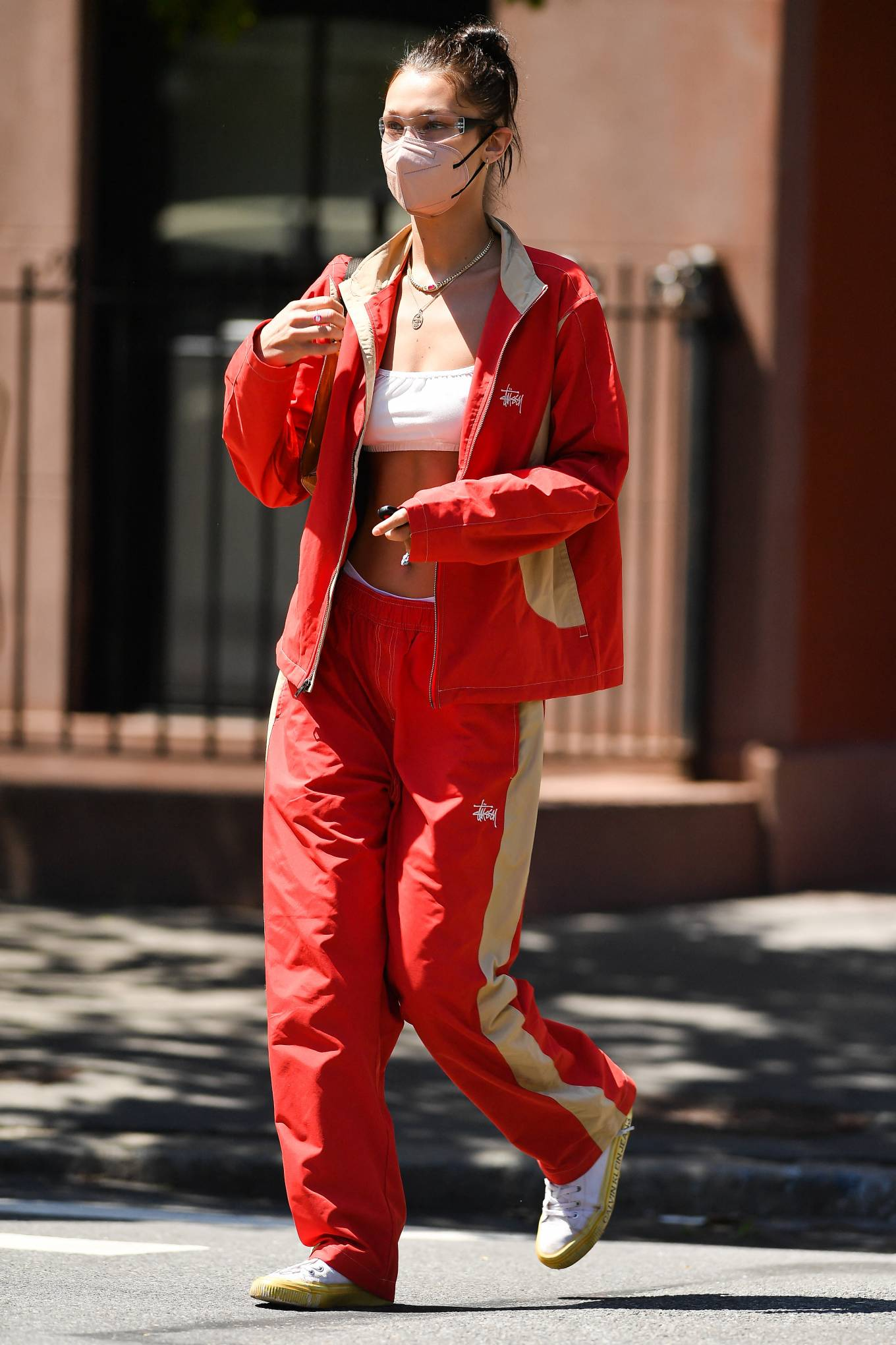 Bella Hadid rocking a relaxed fit red open front nylon jacket with full sleeves, stand-up collar and side pockets