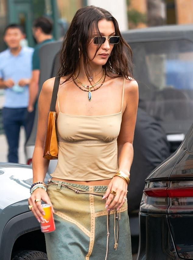 Bella Hadid donning a bi color relaxed fit 90's midi skirt