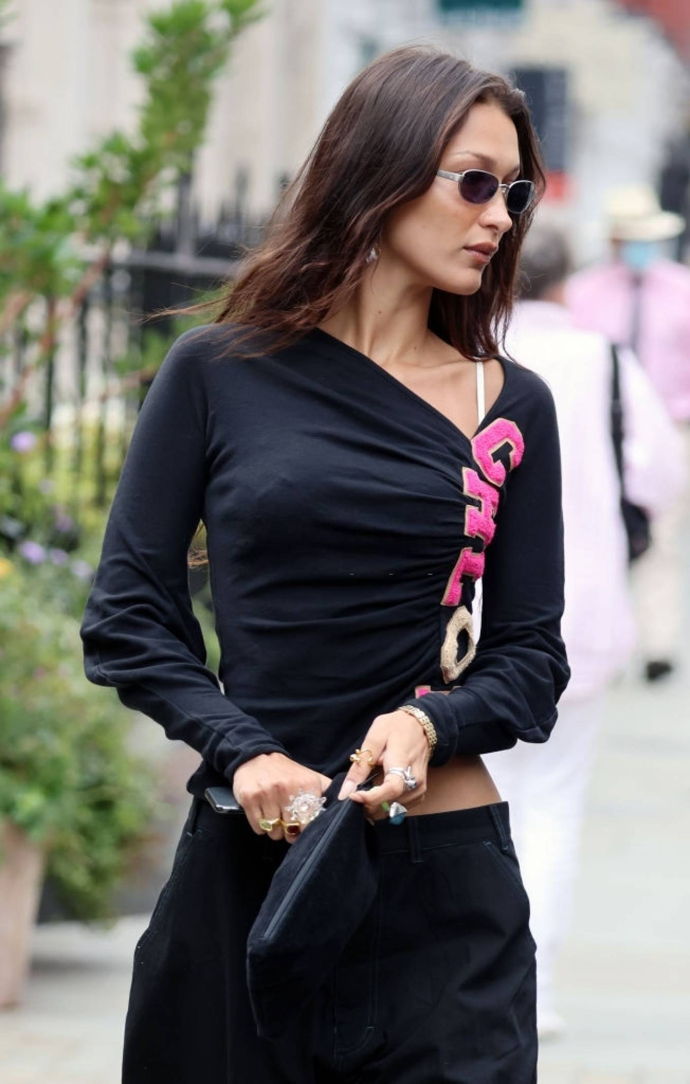 Bella Hadid rocking round black yellow lace-up sneakers