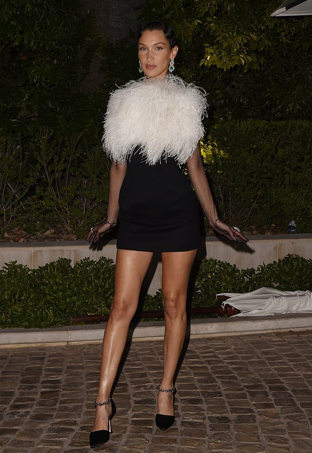 Bella Hadid donning pointed black open toe sandals