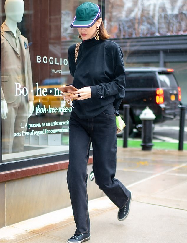 Bella Hadid donning round black grey lace-up sneakers