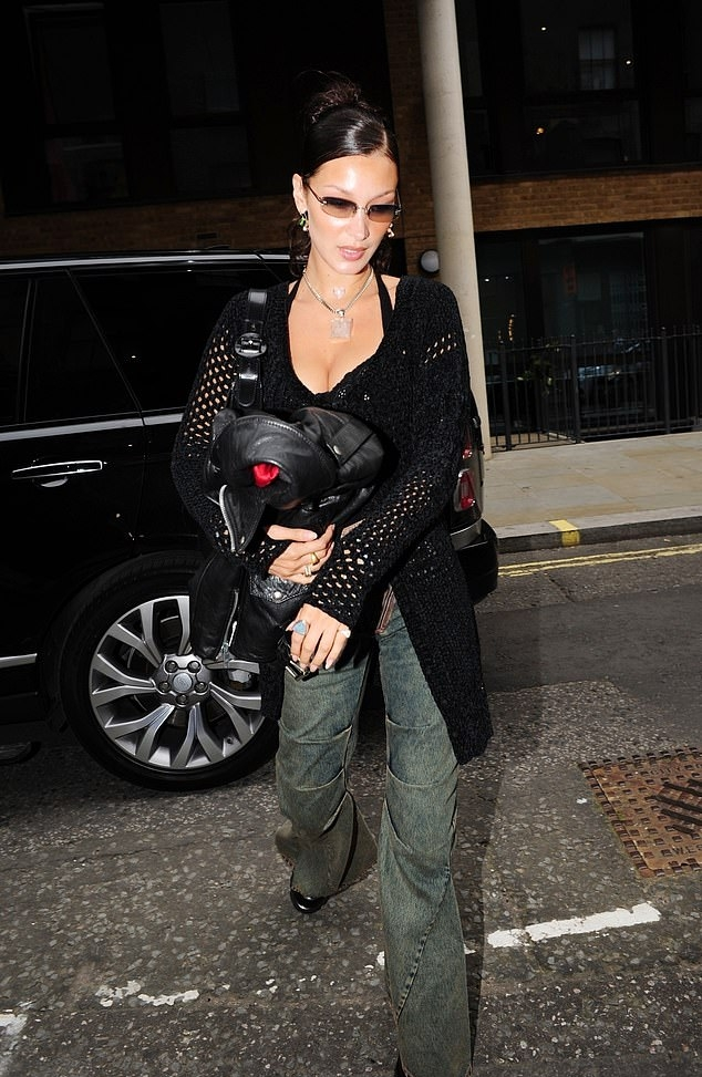 Bella Hadid donning round black leather boots