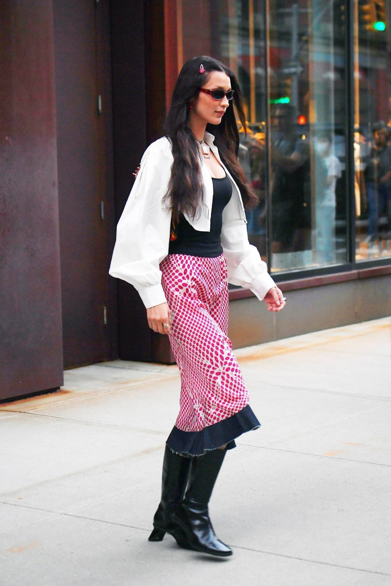 Bella Hadid rocking pointed black high top boots