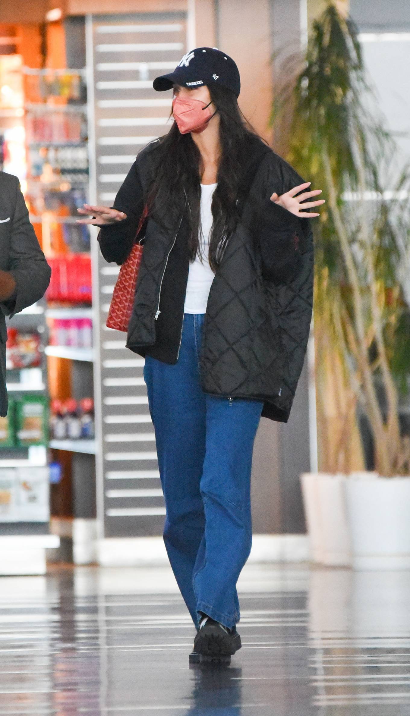 Bella Hadid wearing round black booties