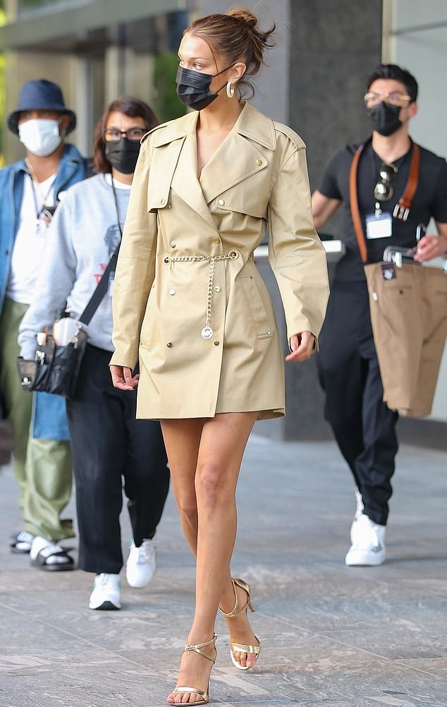 Bella Hadid rocking a button front blazer dress with extra long sleeves, notched lapel collar and flap pockets