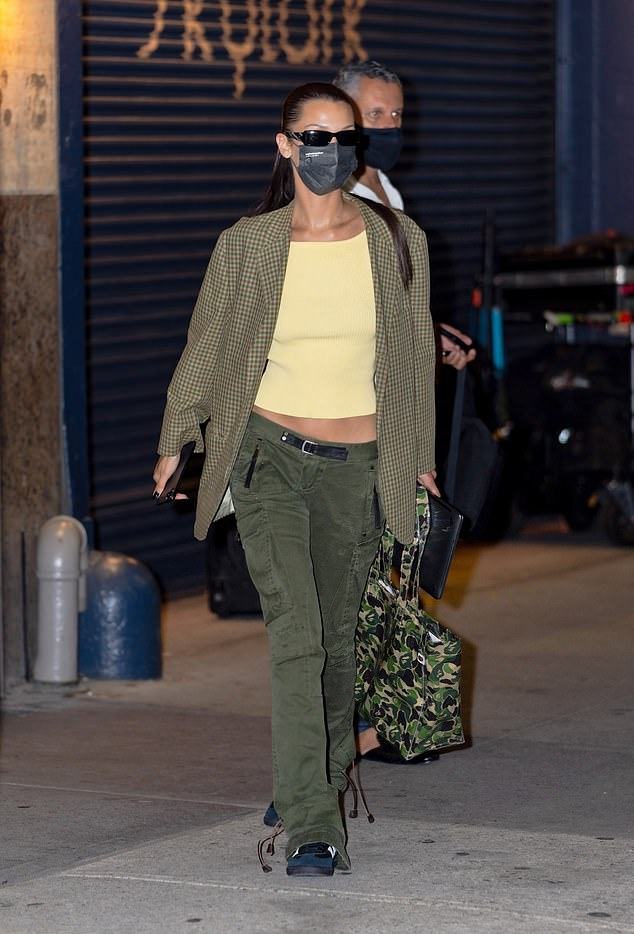 Bella Hadid rocking a oversized green checks blazer with full sleeves, padded shoulder and side pockets