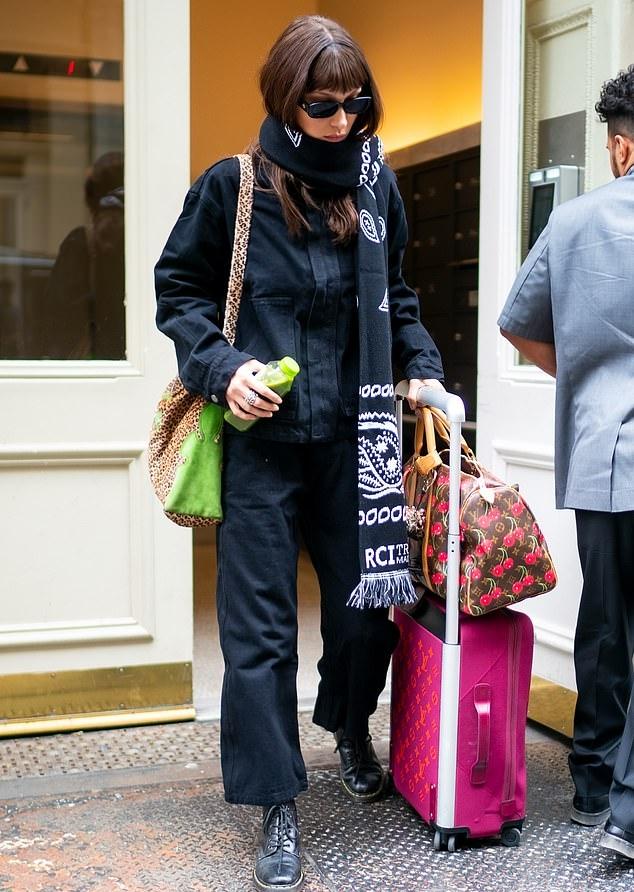 Bella Hadid donning black straight fit pants