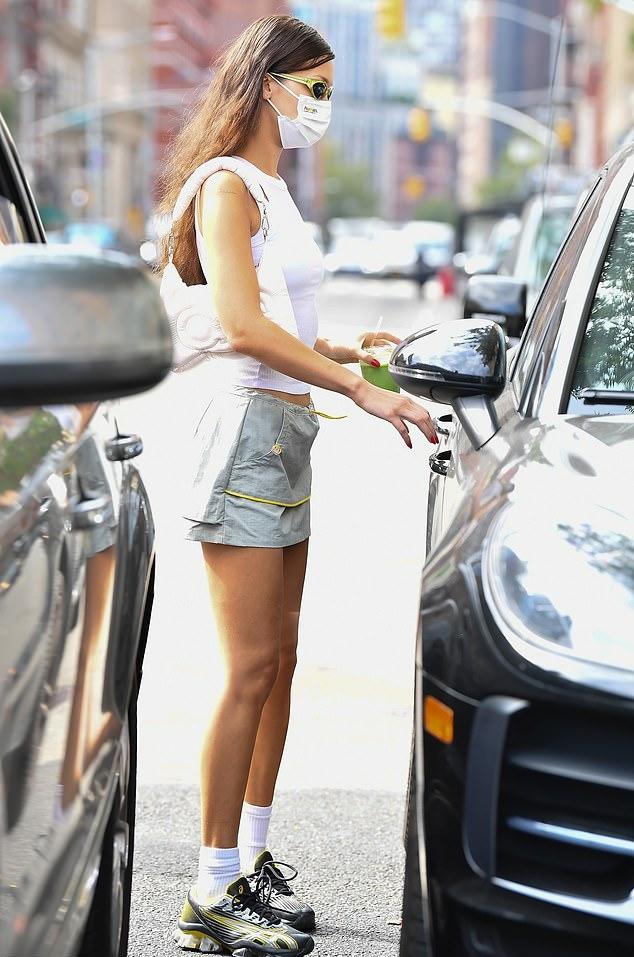 Bella Hadid donning a grey skimpy sporty mini skirt