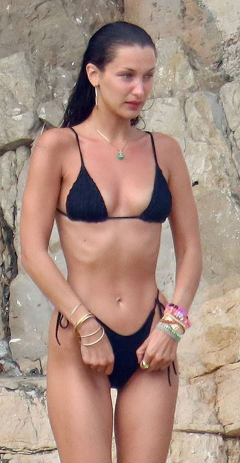Bella Hadid wearing figure hugging black knotted design bikini bottom with high waist with strappy
