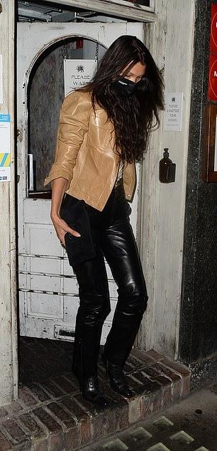 Bella Hadid rocking round black boots