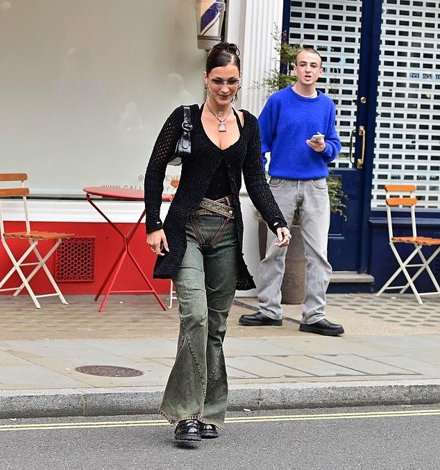 Bella Hadid rocking round black leather boots