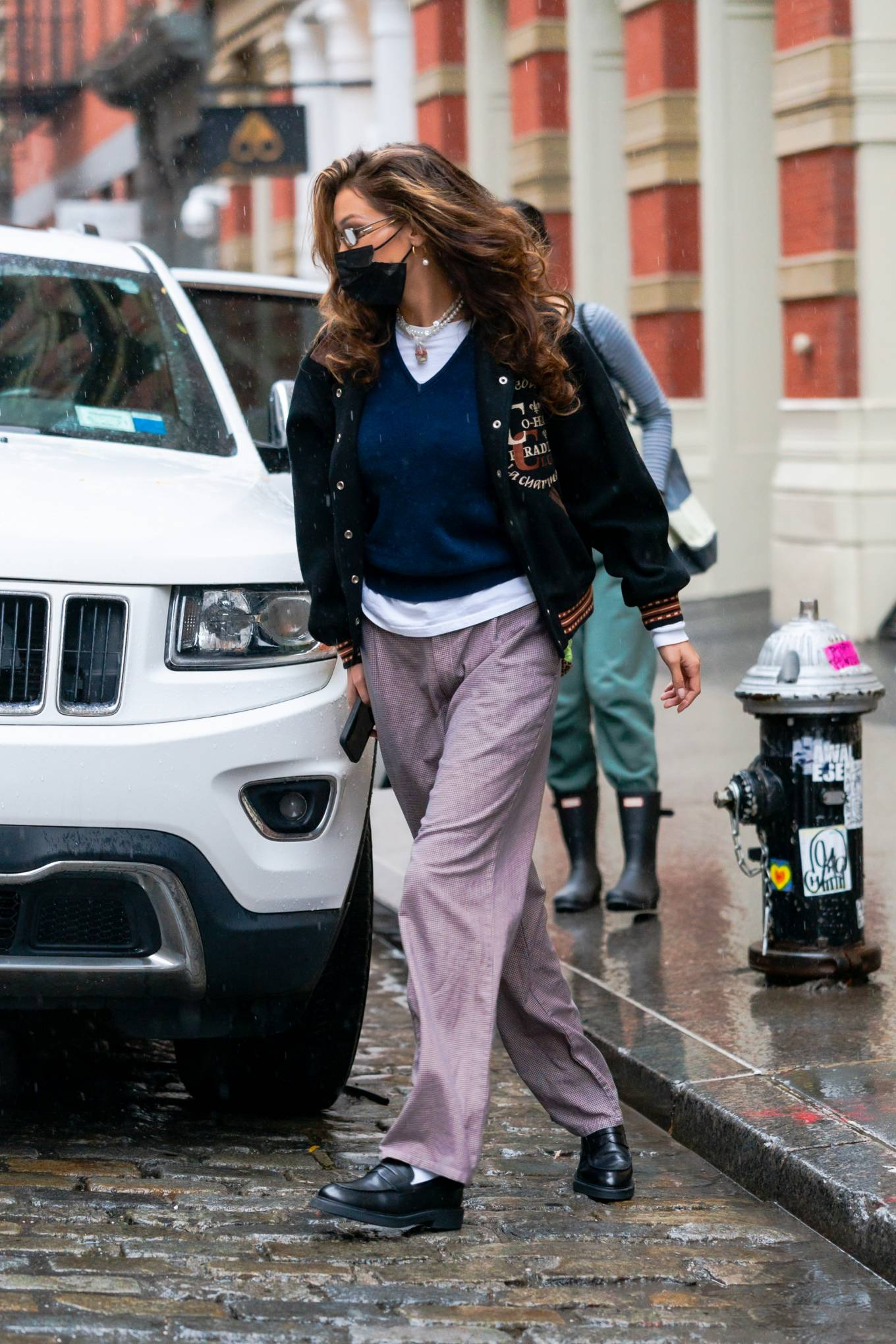 Bella Hadid donning narrow black leather boots