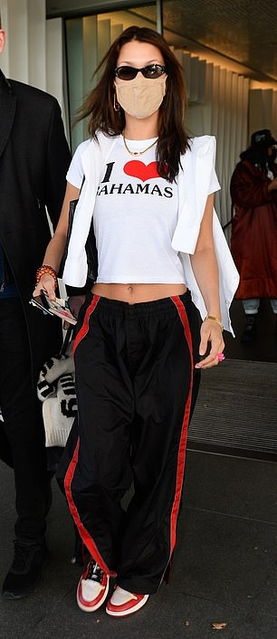Bella Hadid wearing oversized black and red nylon side-striped baggy sweatpants