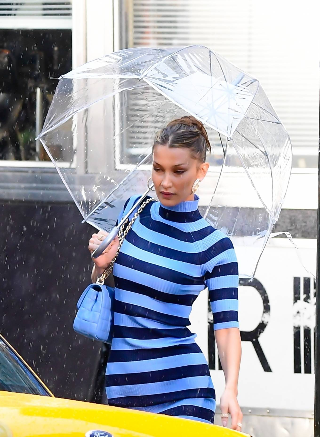 Bella Hadid, white  sneakers, leather, blue purse, figure hugging blue dress, round, metal detailing