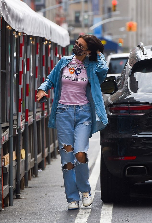 Bella Hadid donning brand logo white blue lace-up sneakers by Adidas