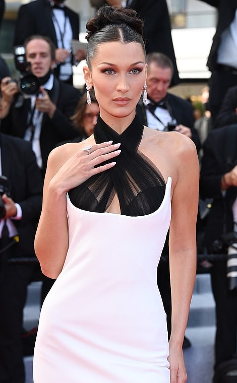Bella Hadid wearing pointed black leather open toe sandals with pointy heel