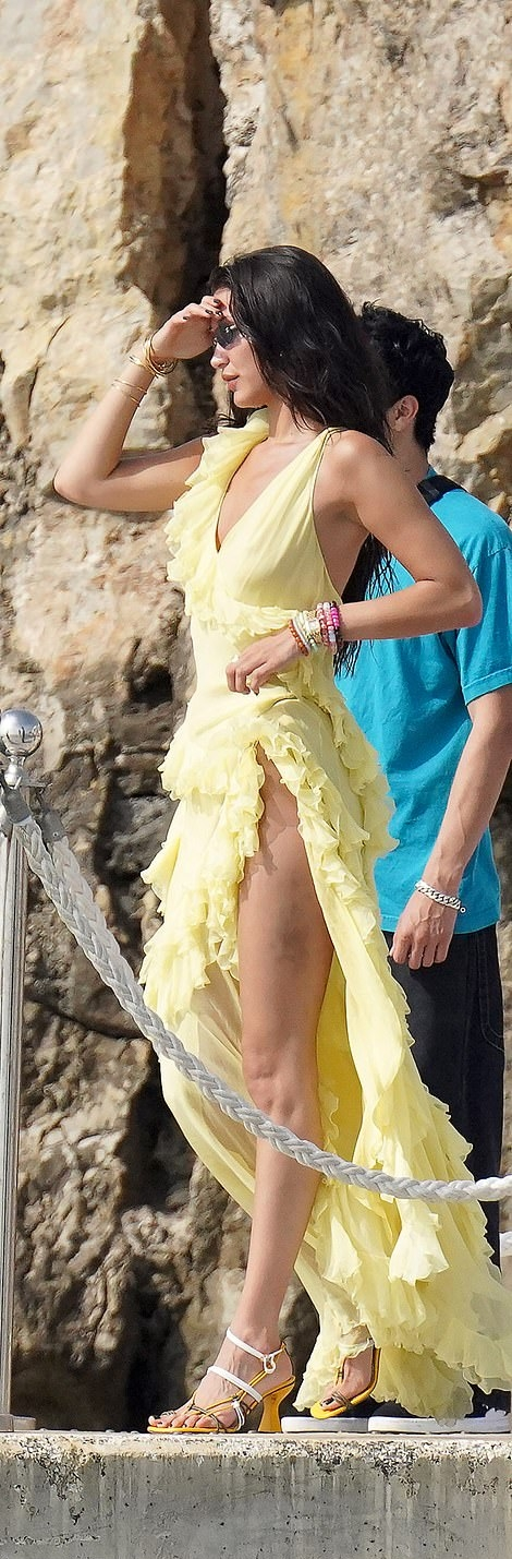 Bella Hadid rocking pointed yellow white open toe sandals with cuban heel