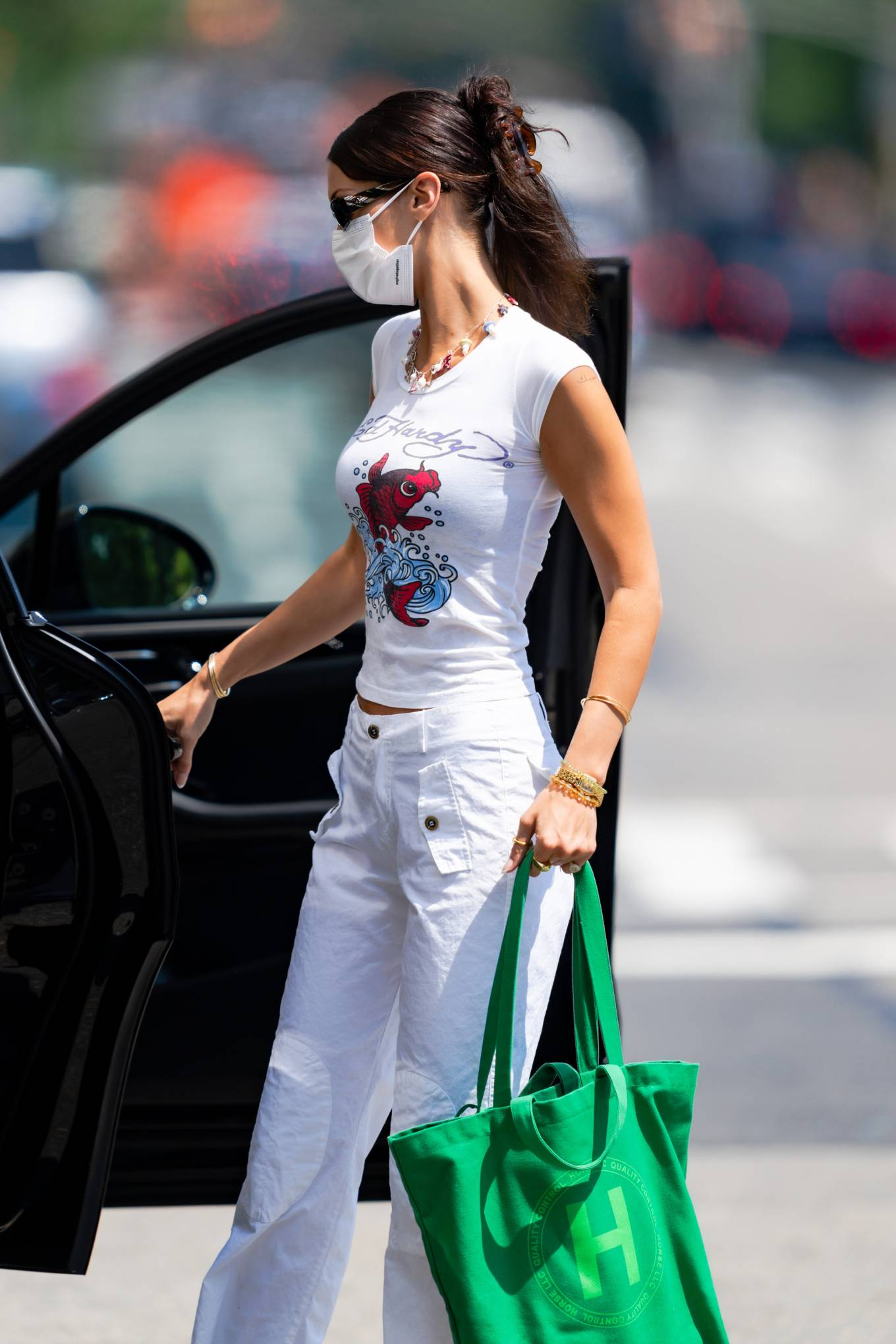 Bella Hadid donning brand logo white leather lace-up sneakers