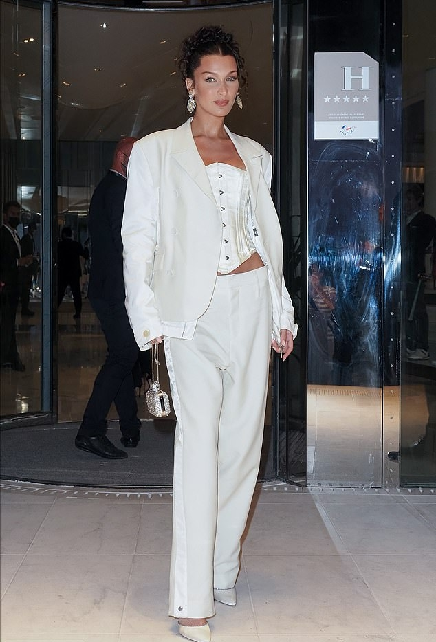 Bella Hadid donning a oversized white blazer with full sleeves and lapel collar