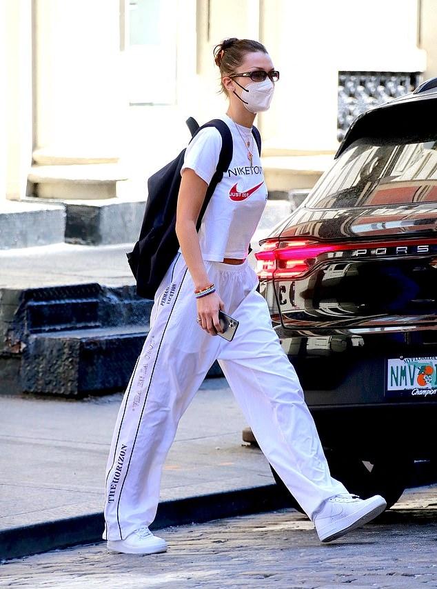 Bella Hadid rocking round white sneakers