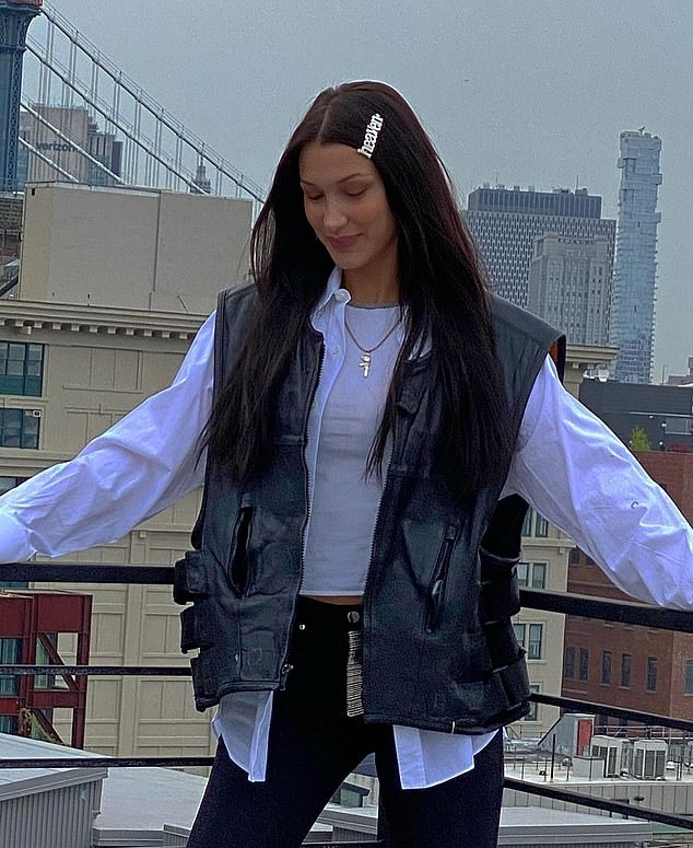 Bella Hadid wearing a white open front cotton shirt with full sleeves, shirt collar and button front