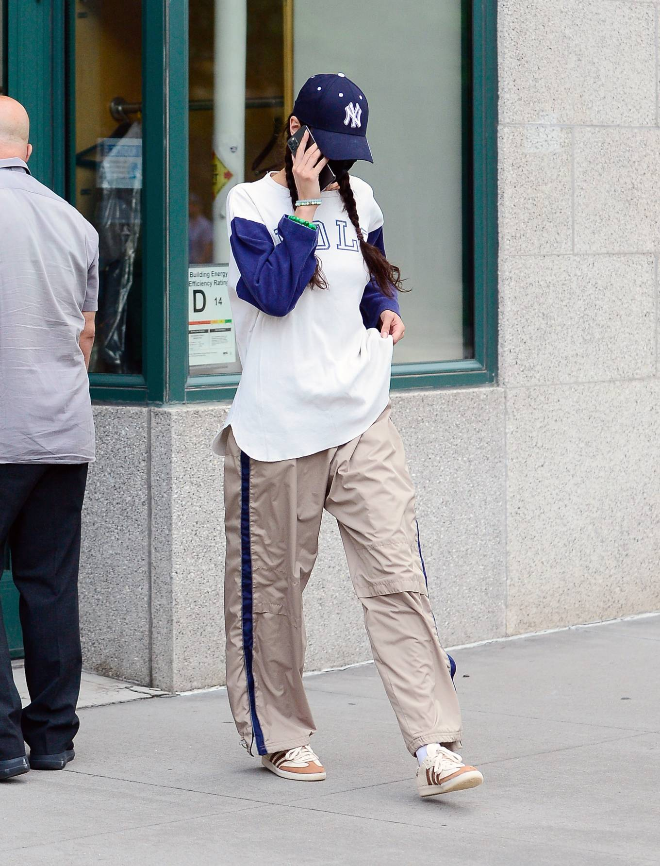 Bella Hadid wearing round white Adidas lace-up sneakers