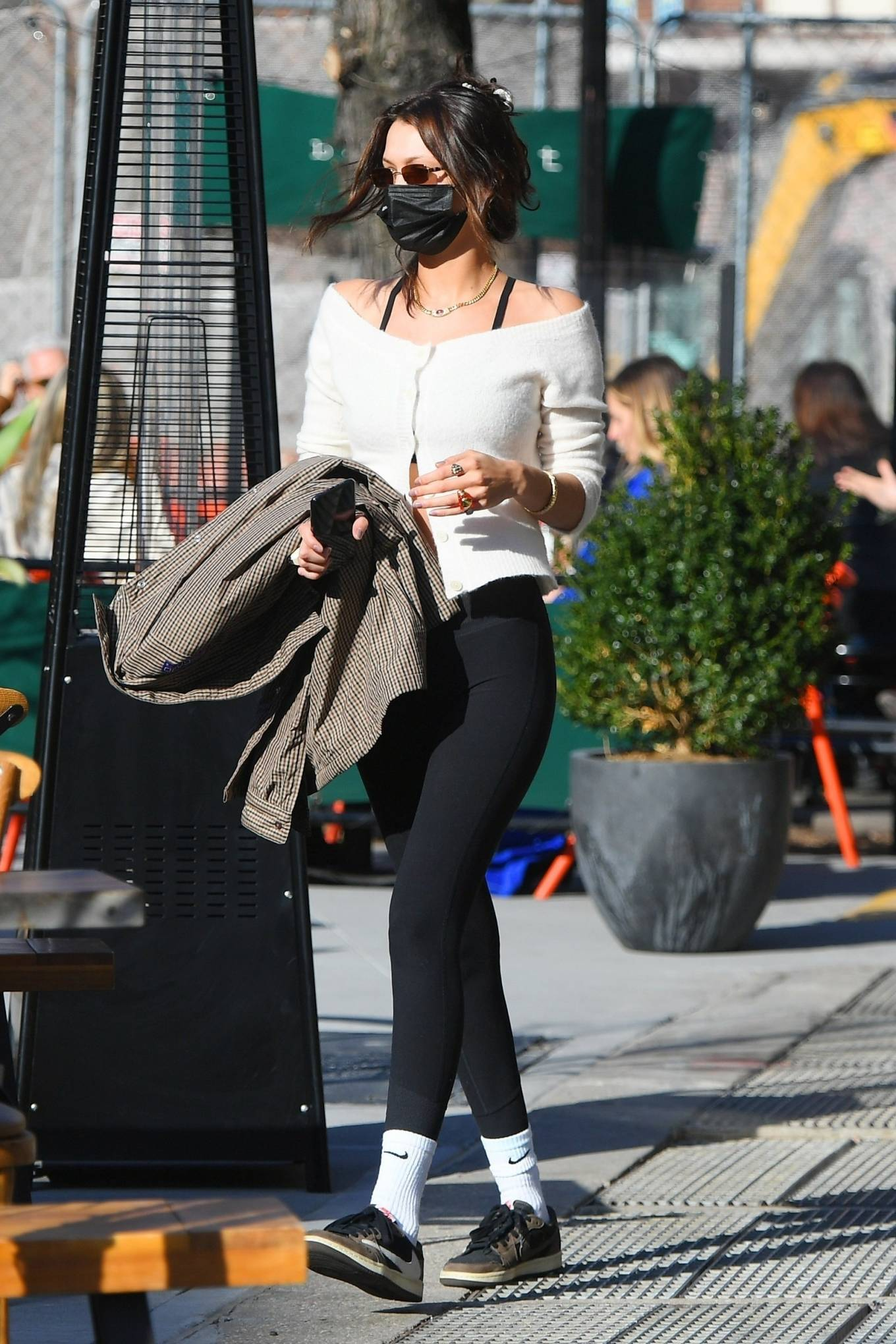 Bella Hadid rocking a grey basic shirt with shirt collar and button front