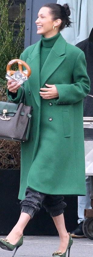 Bella Hadid rocking sharp green slip on sandals with stiletto heels