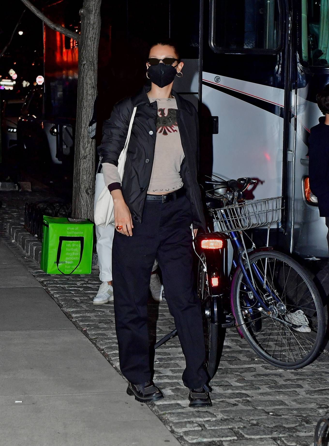Bella Hadid donning round black lace-up boots with chunky heel