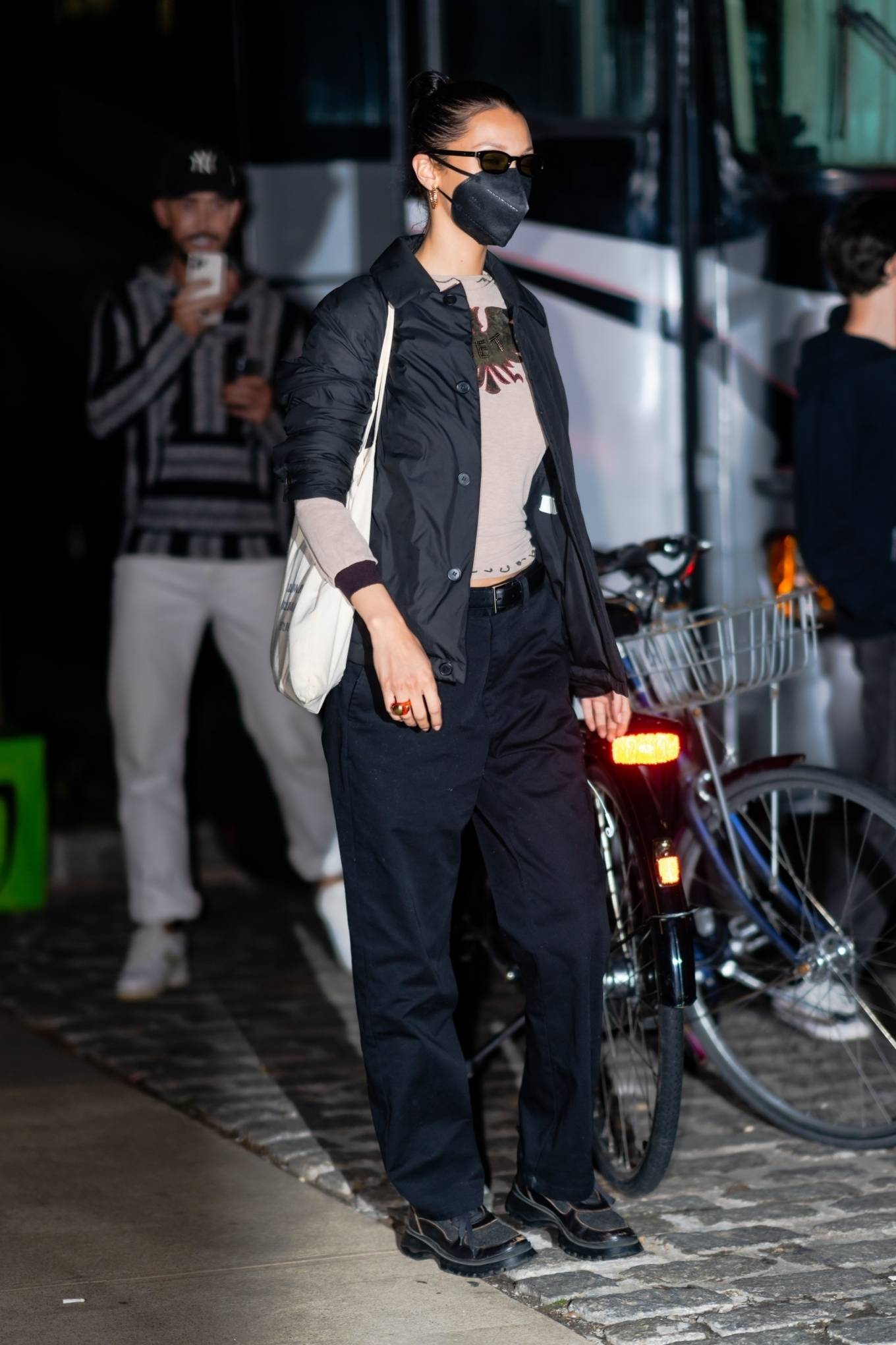 Bella Hadid, black  boots, black jacket, black sunglasses, round, lace-up, chunky heel, nude top, black trousers