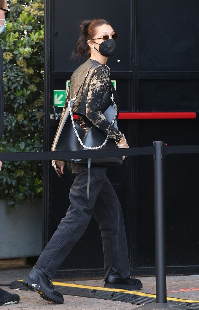 Bella Hadid donning round black leather ankle boots by Off-White with chunky heel