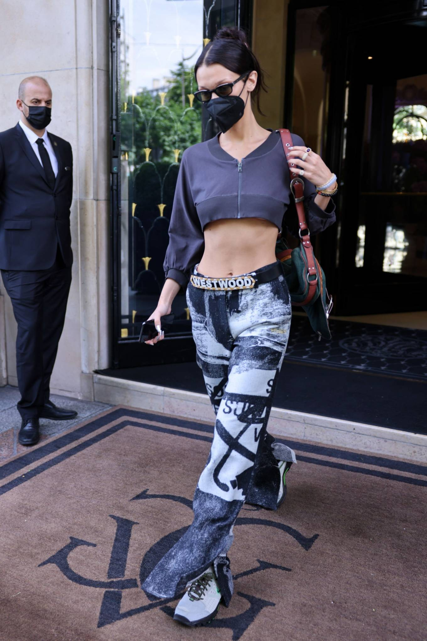 Bella Hadid wearing round grey lace-up sneakers with chunky heel