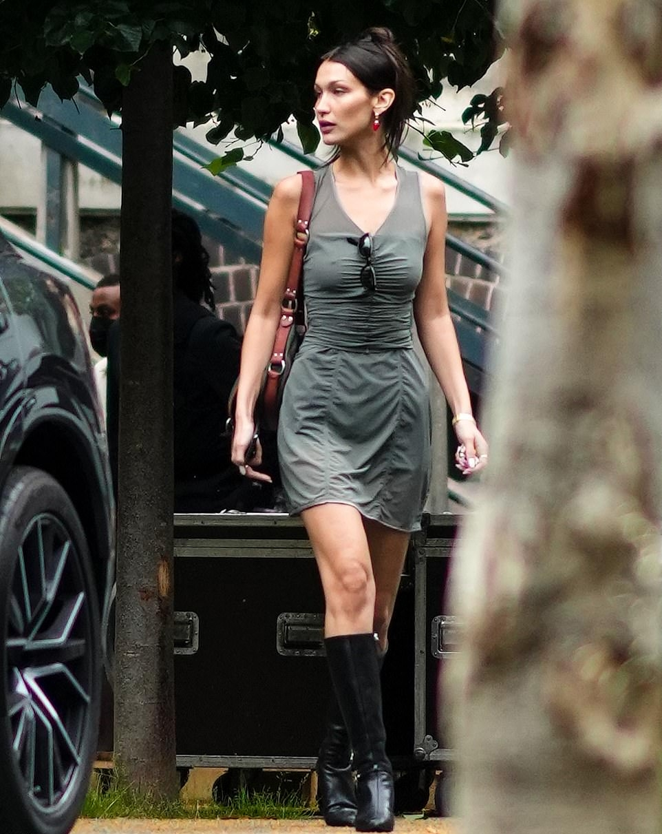 Bella Hadid donning square black leather knee high boots with kitten heel