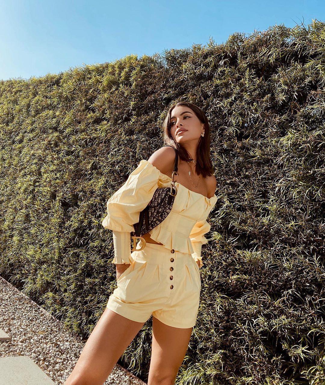 Camila Coelho wearing Pale yellow button up Camila Coelho shorts with high waist with pleated