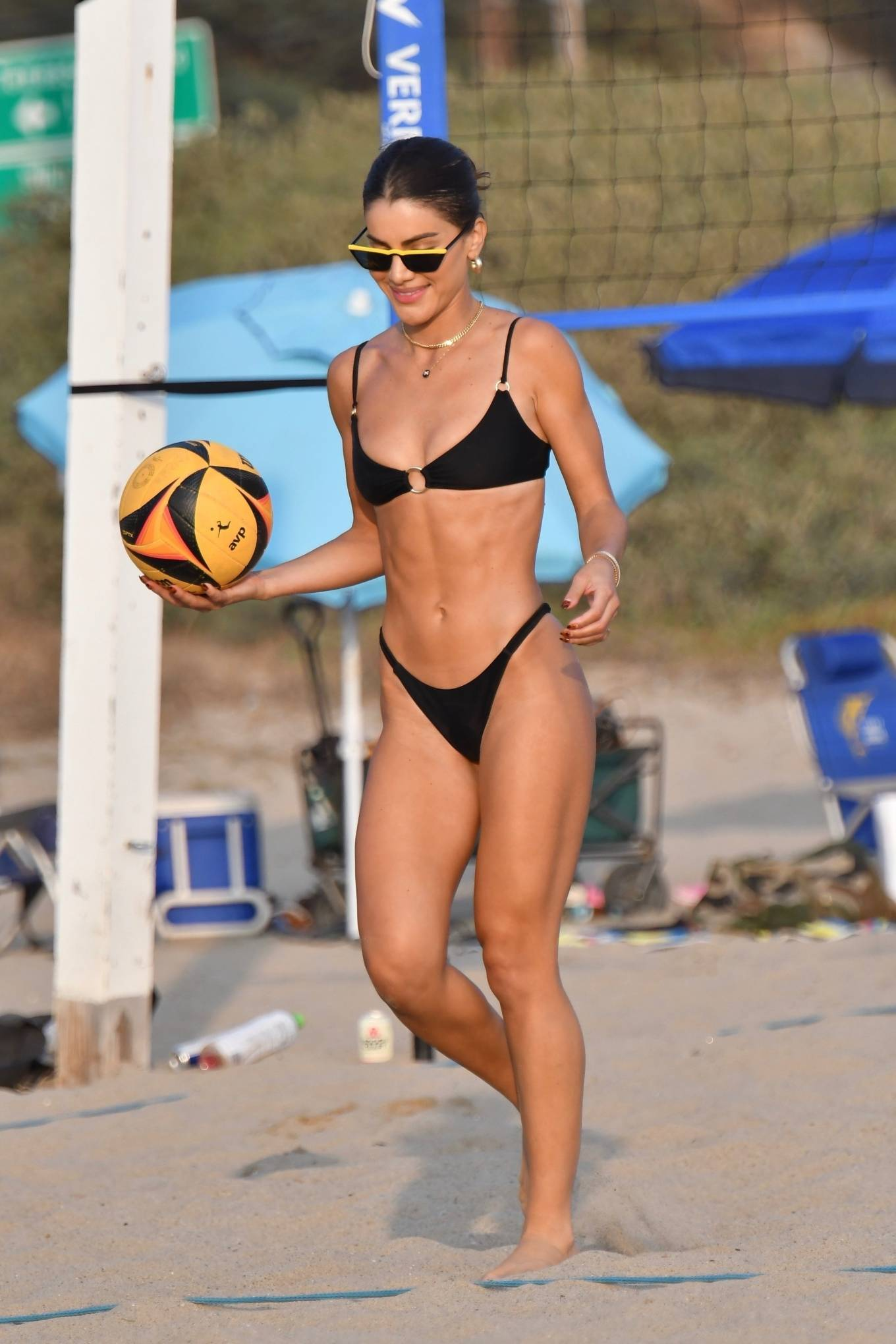 Camila Coelho, black  bikini top, black sunglasses, show, metal detailing, sexy, thin shoulder strap, scoop neck, plunging
