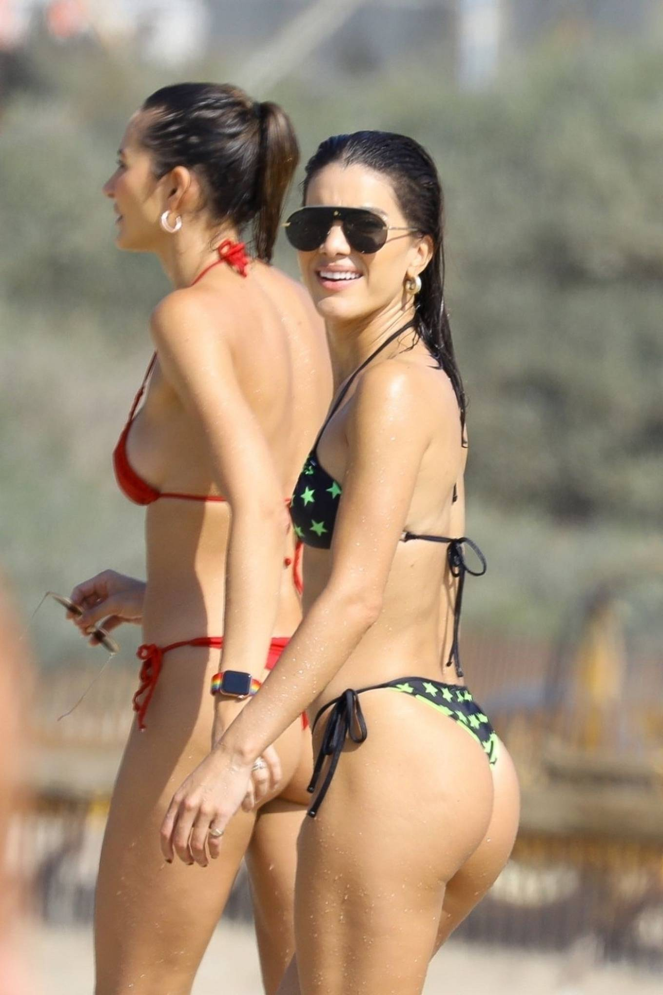 Camila Coelho rocking a plunging black bikini top with spaghetti straps