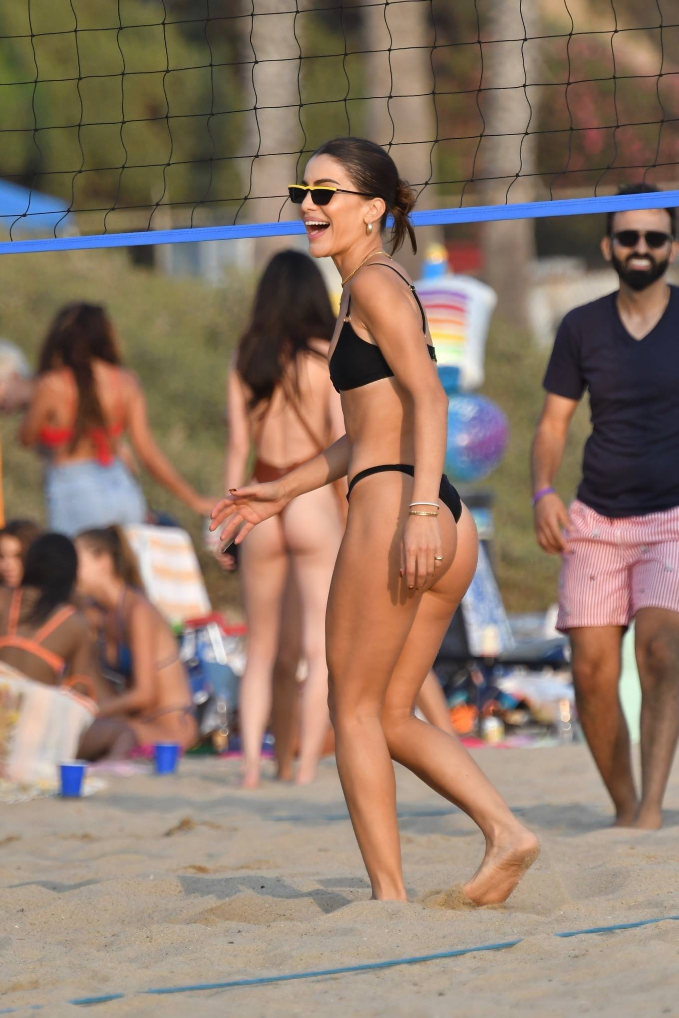 Camila Coelho, black  bikini top, black sunglasses, sexy, thin shoulder strap, scoop neck, plunging, show, metal detailing