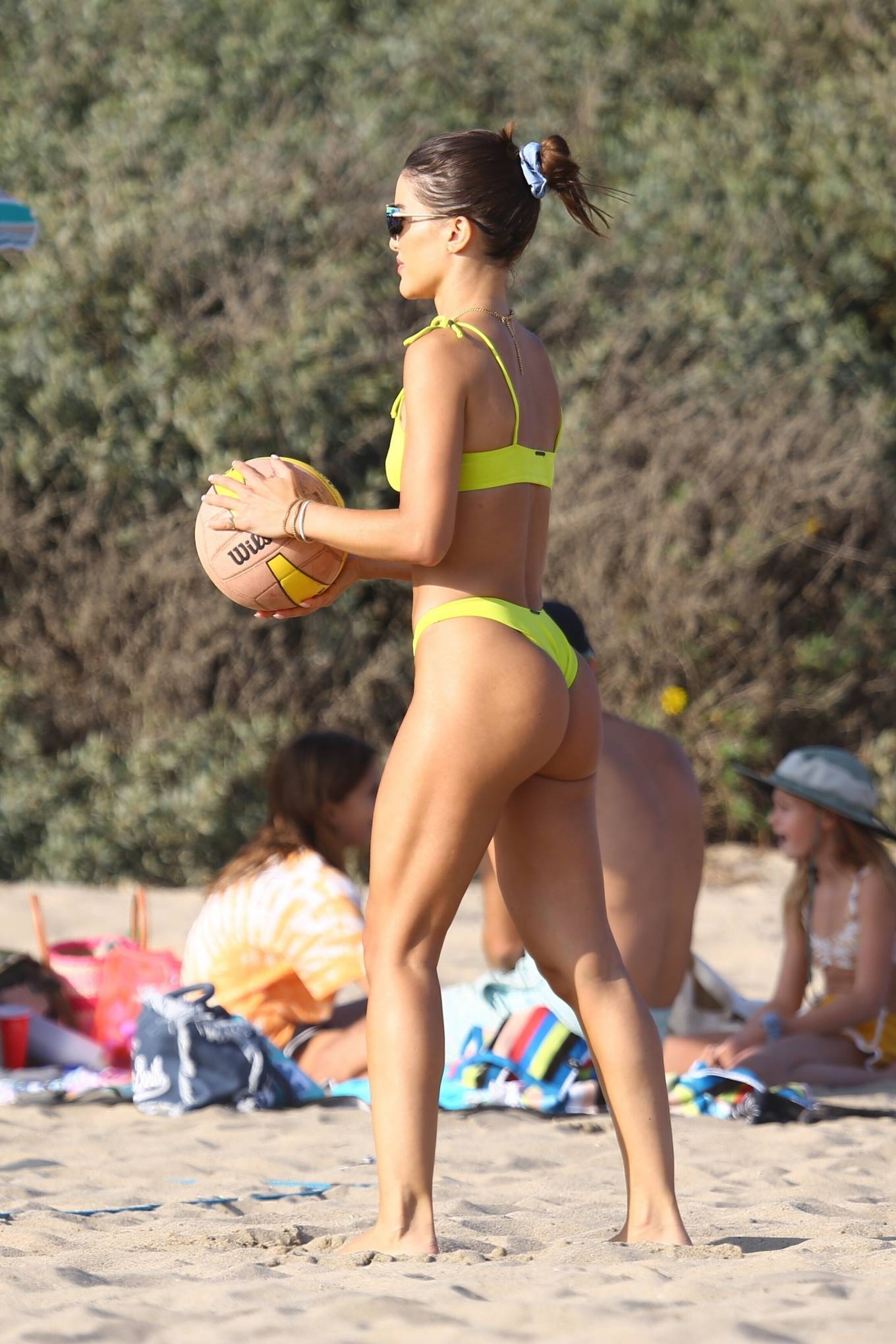 Camila Coelho, yellow green  bikini bottom, yellow green bikini top, green wayferer, show, sexy, skimpy, matching