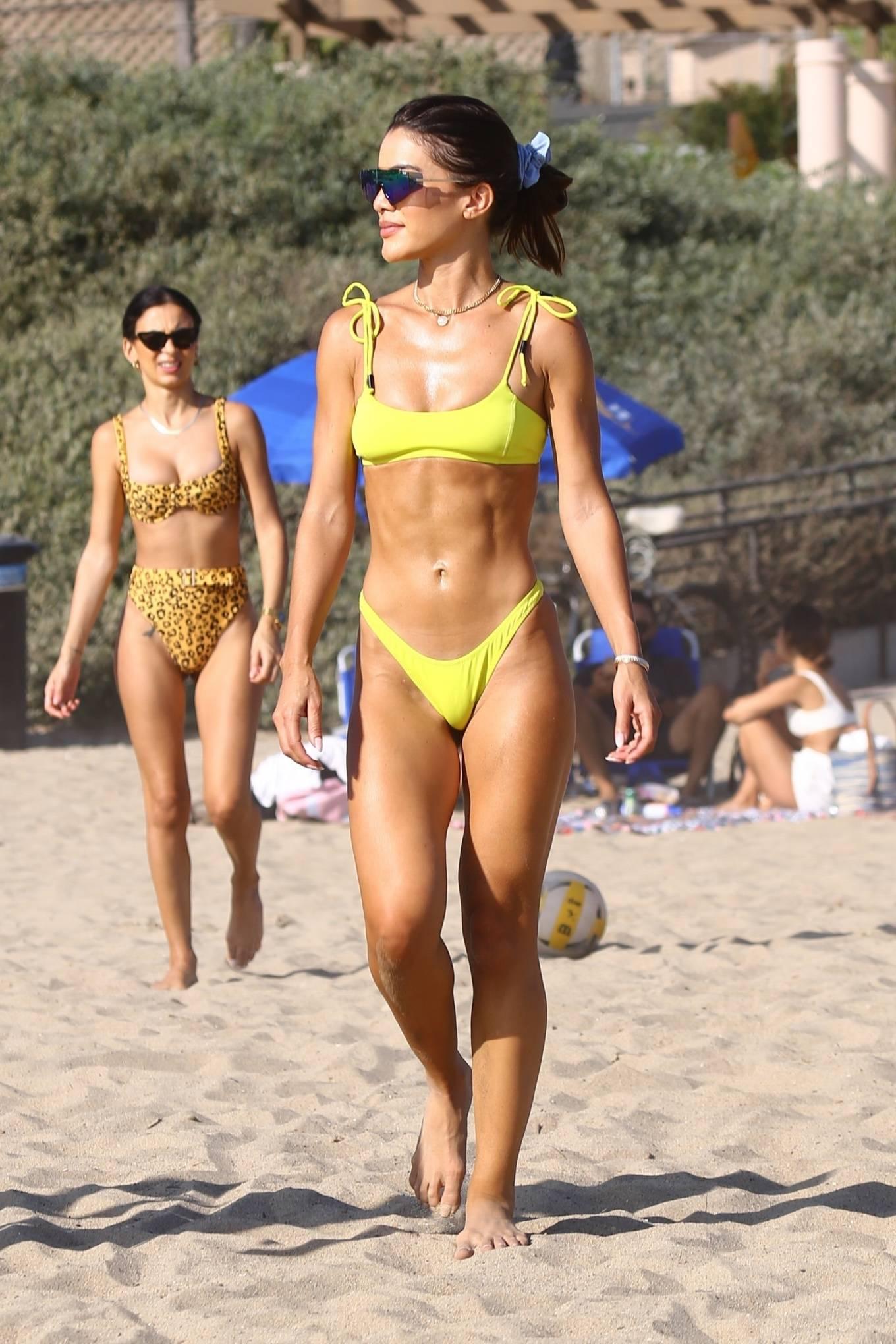 Camila Coelho rocking Yellow green bikini bottom