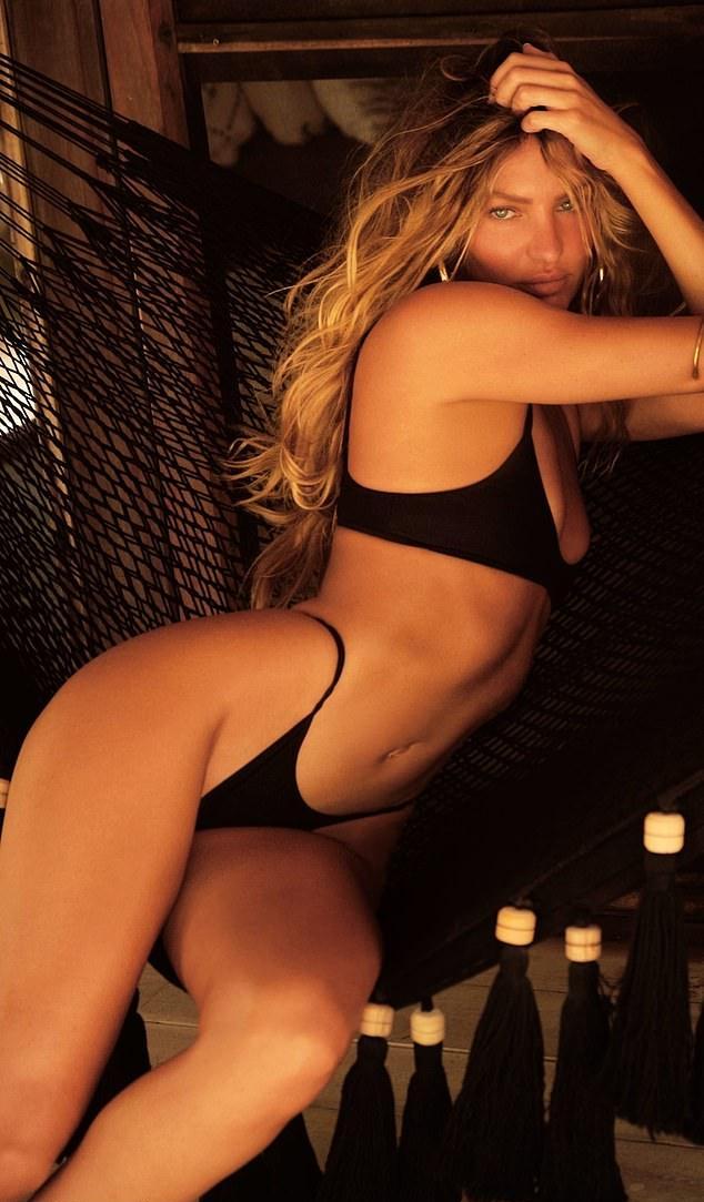 Candice Swanepoel donning skimpy black low rise skinny bikini bottom